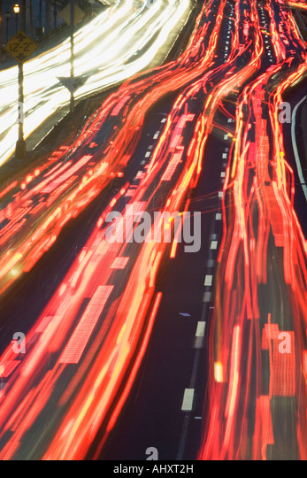 Blurred motion shot of traffic on large highway - Stock Image
