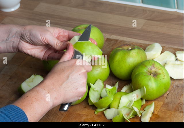 Apples being prepared for a pie UK - Stock-Bilder
