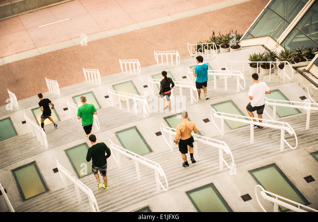 Group of runners training on convention center steps - Stock Image