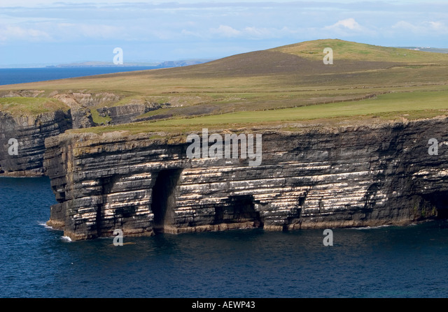 Sea Arch And Sea Stack Ireland Stock Photos & Sea Arch And ...
