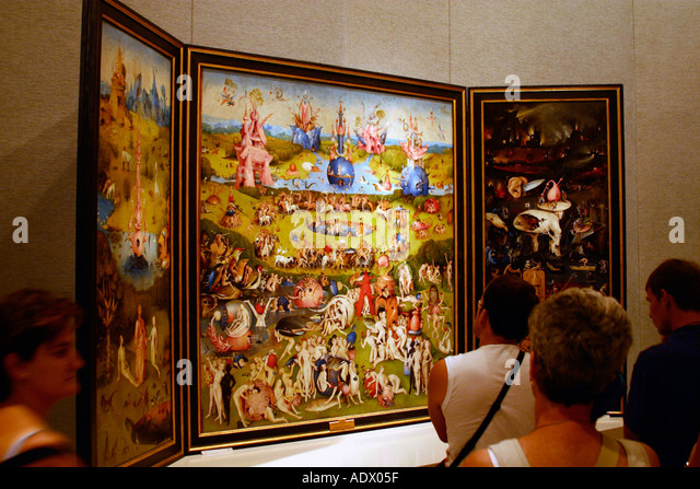 Museo del Prado Museum tourists admire Garden of Earthly Delights by Hieronymus Bosch Spain - Stock Image