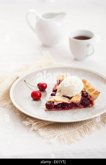 Piece of cherry pie with ice cream. - Stock Image