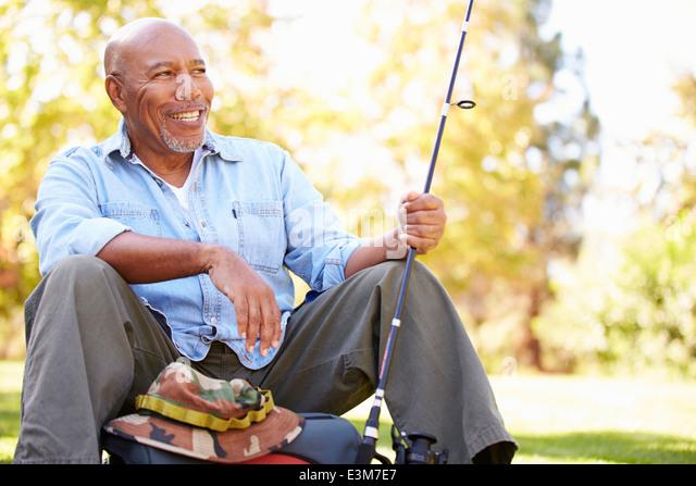 Senior Man On Camping Holiday With Fishing Rod - Stock-Bilder