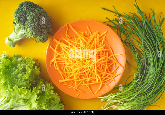 Fresh herbs and carrots on the table horizontal - Stock Image