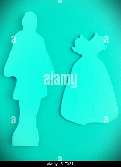 Monochrome cutout figures of a female form and a dress. - Stock Image