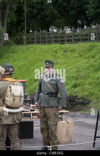 German field police officer with smile talking to american soldier