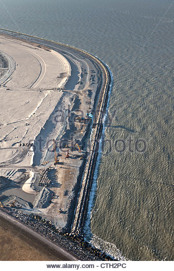 Dike construction. Port expansion by claiming land from the sea. Project called Maasvlakte 2. Aerial. - Stock Image
