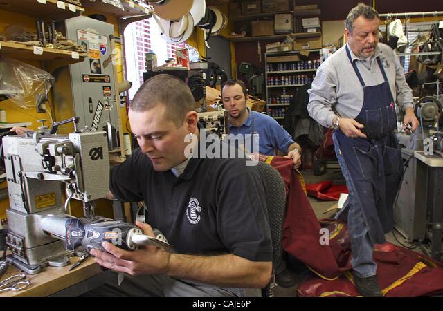Jan 22, 2008 - St. Paul, Minnesota, USA - DAN GEORGE repaired a hockey skate and Brian George repaired Gopher Hockey - Stock Image