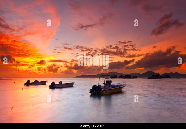 Colorful sunset on Seychelles with a beautiful clouds. Island La Digue. - Stock Image