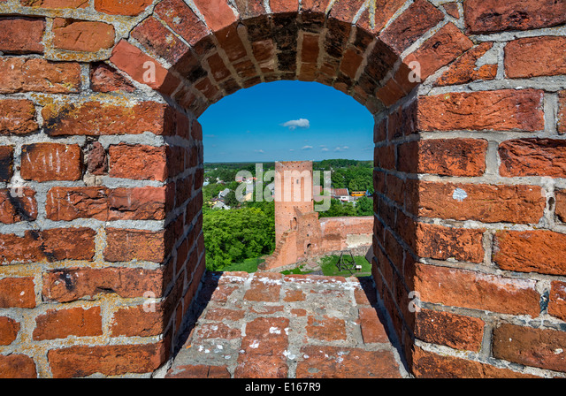 West Tower seen through embrasure at South Tower of medieval Mazovian Princes Castle near village of Czersk, Mazovia, - Stock Image