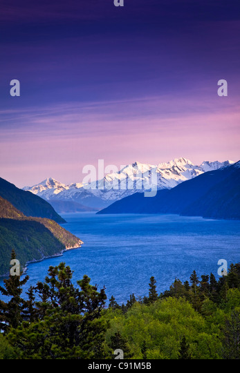 Scenic view of Lynn Canal and the Chilkat Mountains near Skagway at sunset, Southeast Alaska, Summer - Stock Image