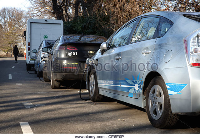 Hybrid Electric car charging station in New York City, USA - Stock Image