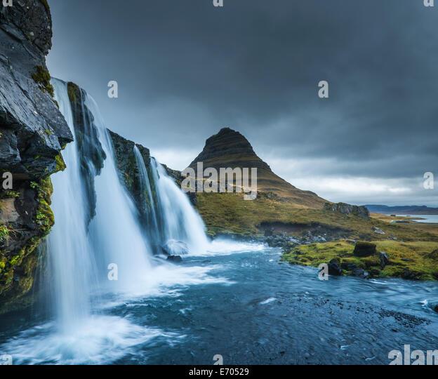 Kirkjufellsfoss waterfall, Mt. Kikjufell in background, Snaefellsnes, Iceland - Stock-Bilder