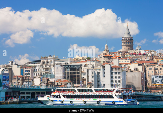 Galata bridge spanning the Golden Horn, Istanbul and Galata Tower, Istanbul, Turkey - Stock Image