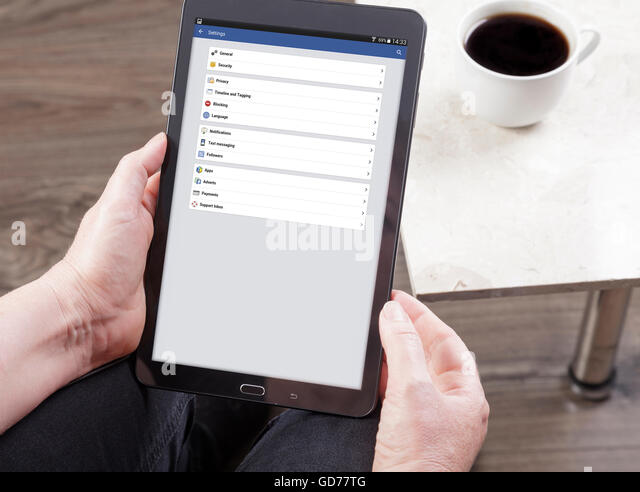 viewing Facebook settings on a tablet - Stock Image