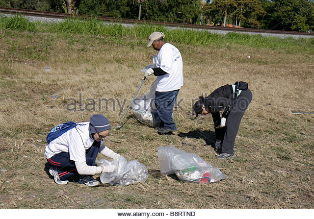 Miami Florida Oakland Grove Annual Little River Day Clean Up trash pick up picking litter clean pollution volunteer - Stock Image