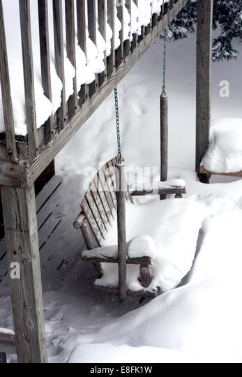 USA, Michigan, Country-house wooden swing - Stock Image