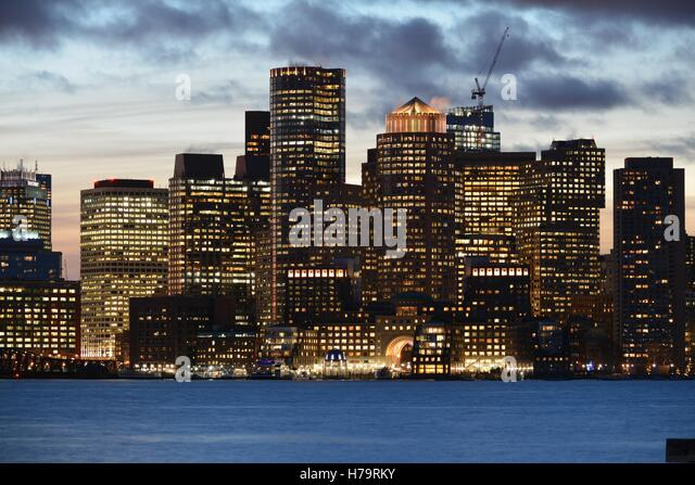 The downtown Boston skyline at sunset, seen from across Boston Harbor. - Stock Image