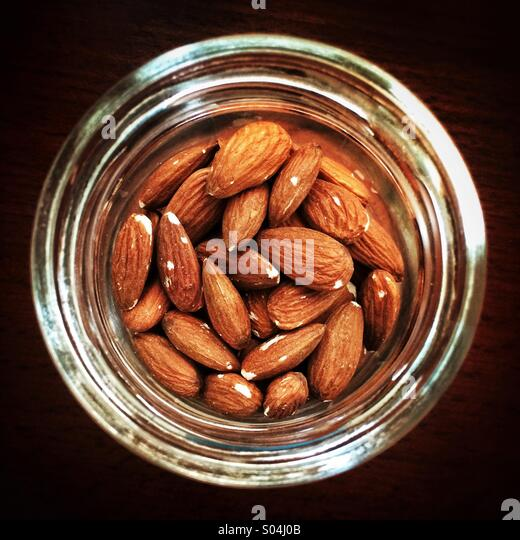 A jar of almonds - Stock Image