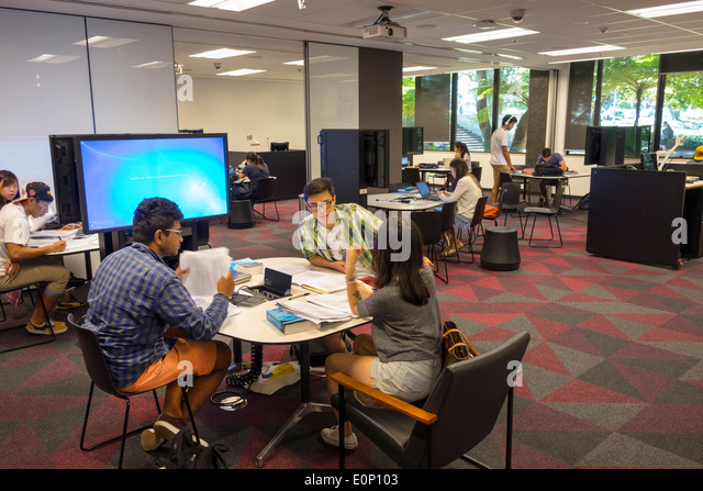 Sydney Australia NSW New South Wales University of Sydney education campus Fisher Library student Asian man woman - Stock Image