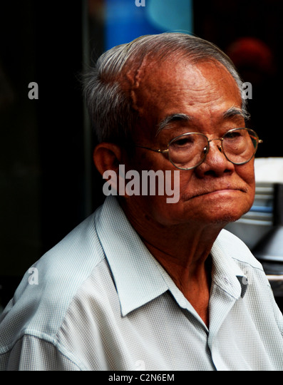 thai chinese man lost in his thoughts , emotions and expressions , everyday life, bangkok story, bangkok, thailand - Stock-Bilder