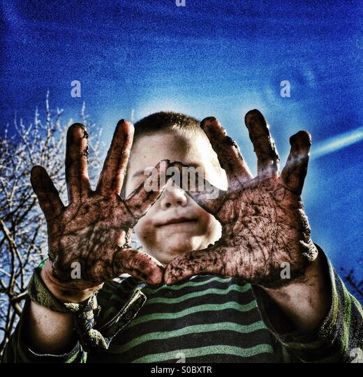 Muddy Hands - Stock Image