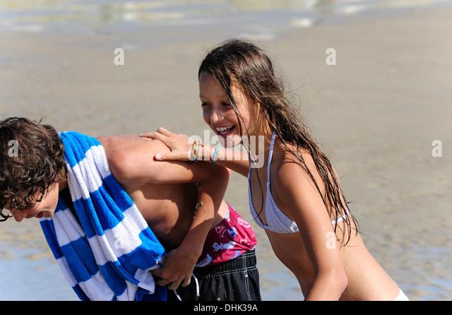 Holland, Zeeland, Domburg, boy and girl having fun on the beach - Stock Image