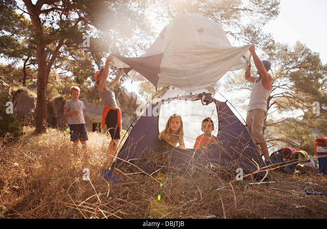 Croatia, Dalmatia, Family holidays on camping site, pitching the tent - Stock-Bilder