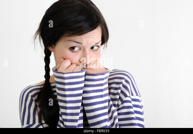 portrait of worried young woman - Stock Image