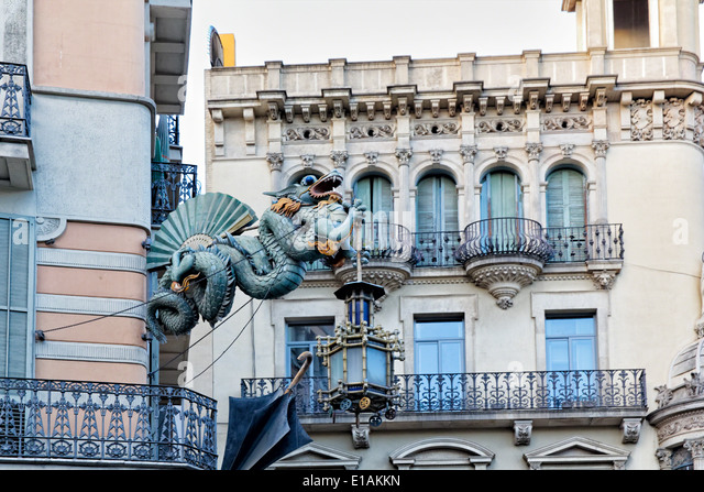 Chinese Dragon Sculpture on the Walls of a House Decorated with Umbrellas,  Bruno Quadras Building, Las Ramblas, - Stock Image