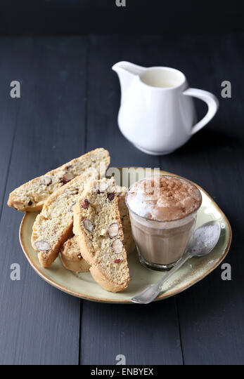 Italian biscotti on plate with a cup of coffee - Stock Image