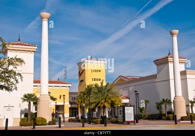 Premium Outlet shopping mall  with J Crew and Izod store signs on International Drive, Orlando Florida - Stock Image