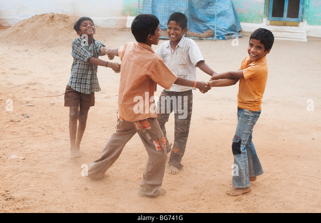 Indian boys swinging around in their village. Andhra Pradesh, India - Stock Image