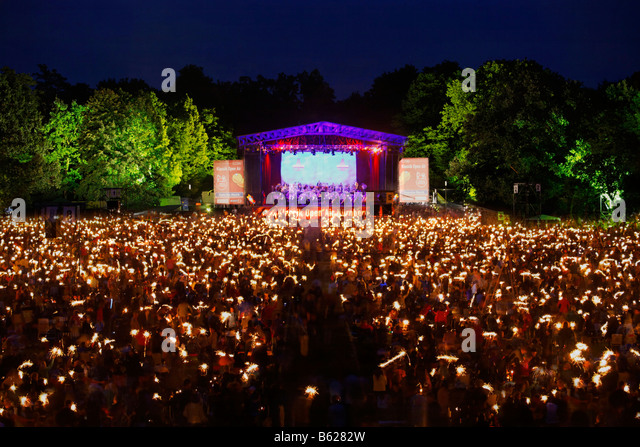 Public with sparklers, Klassik Open Air, Nuremburg Symphony Orchestra, illuminated stage, Luidpoldhain, Nuremberg, - Stock-Bilder