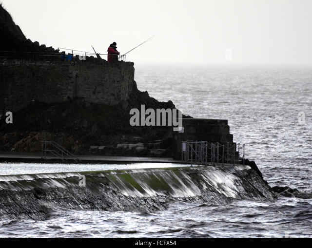 Clevedon, UK. 22nd January, 2016. UK Weather. A nice way to end the day sea fishing at Clevedon sea front. © - Stock Image
