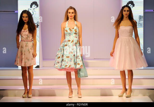 Fashion models wearing dresses by Hellbunny on the womenswear catwalk at Moda, Birmingham NEC, UK, 22nd February - Stock-Bilder