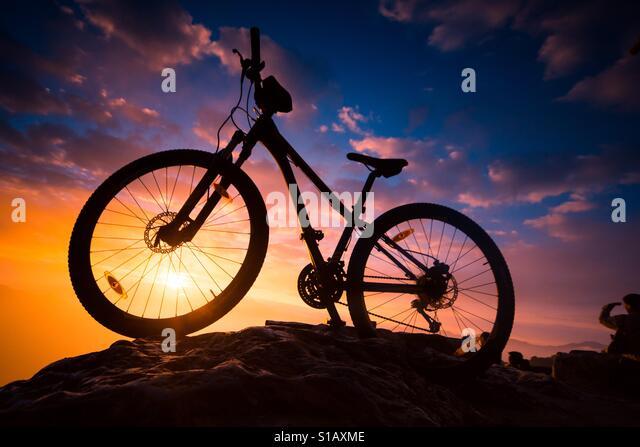 Bicycle at sunrise - Stock-Bilder