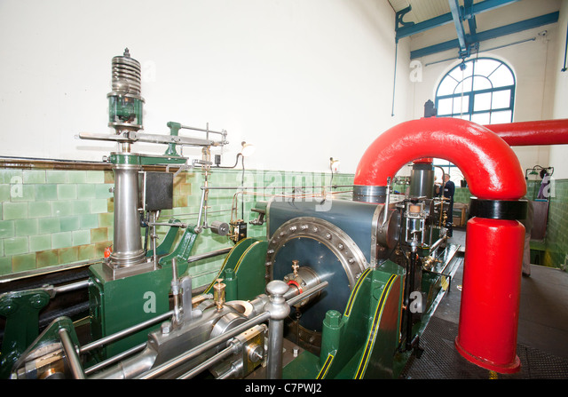 The steam engine, Peace ,at Queens Mill in Burnley. The steam engine was built over 100 years ago and is still powering - Stock Image