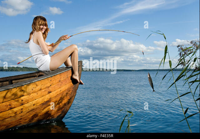 A woman sitting on a boat, Sweden. - Stock Image