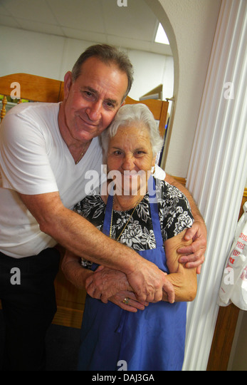 Florida Tarpon Springs Greek community The Original Mama Maria's Greek Cuisine restaurant senior woman immigrant - Stock Image