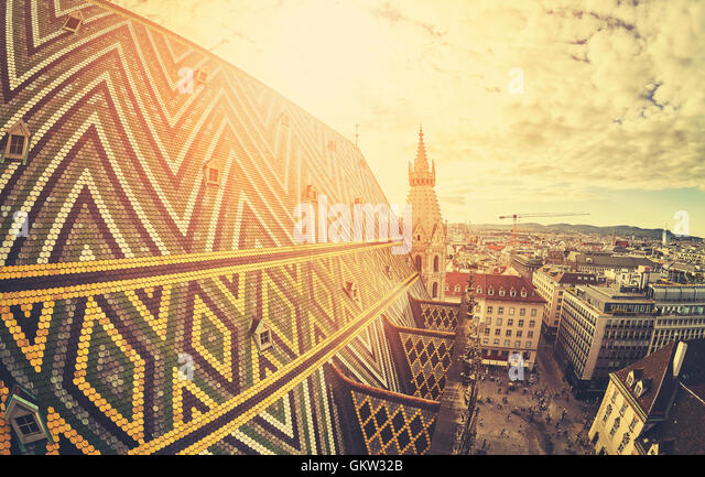 Retro stylized fisheye lens picture of Vienna at sunset, view from the north tower of St. Stephen's Cathedral, - Stock Image
