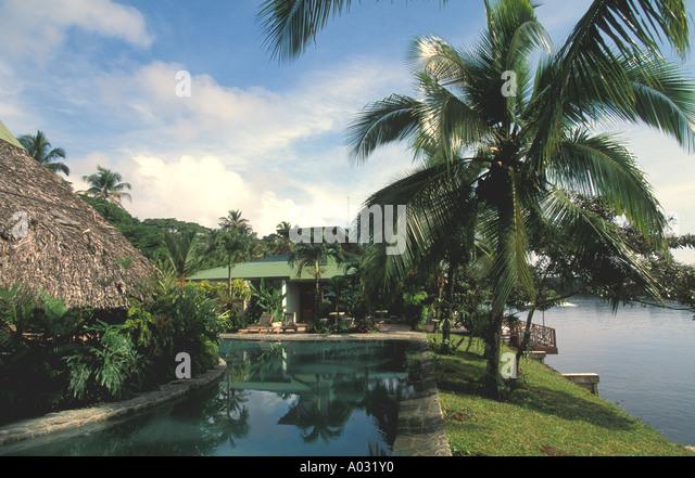 costa rica tortuguero tortuga lodge swimming pool ecotourism nature travel escape primitive luxury thatch roof palm - Stock Image