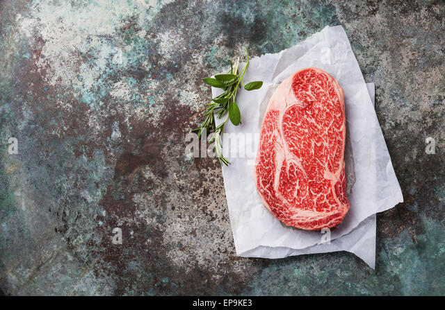 Raw fresh marbled meat Black Angus Steak Ribeye on metal background - Stock Image