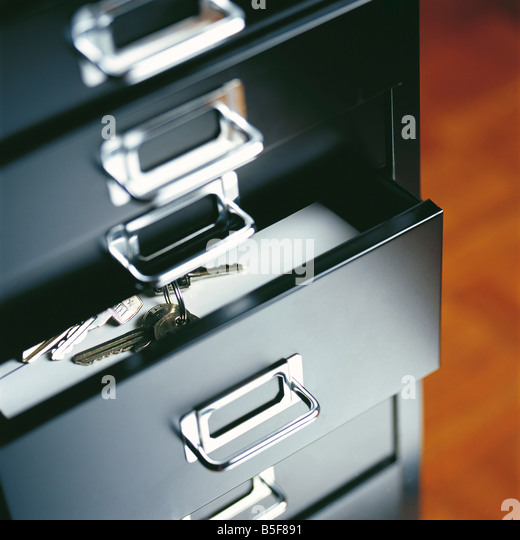 Bunch of keys in an open drawer - Stock Image