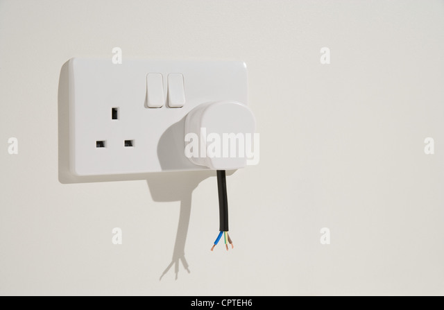 Cut cable and wires of electrical plug - Stock Image