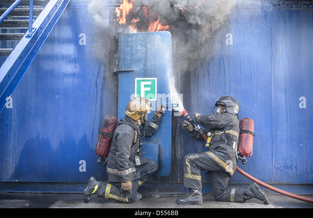 Firefighters in simulation training - Stock Image