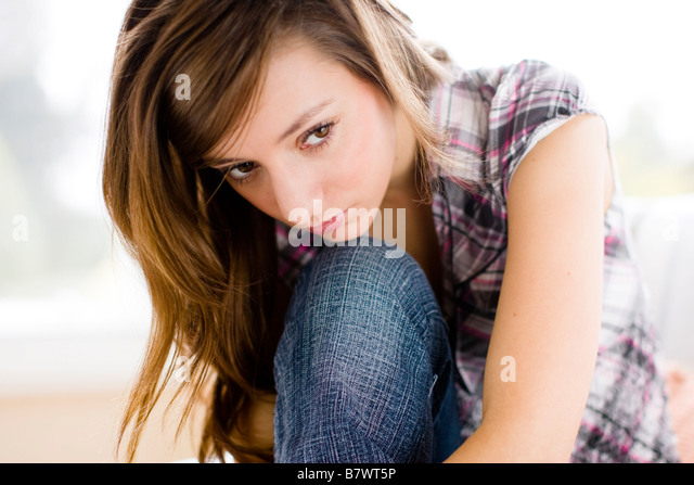 Stressed Girl with hands on her head - Stock Image