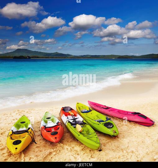Colorful kayaks on the tropical beach - Stock Image