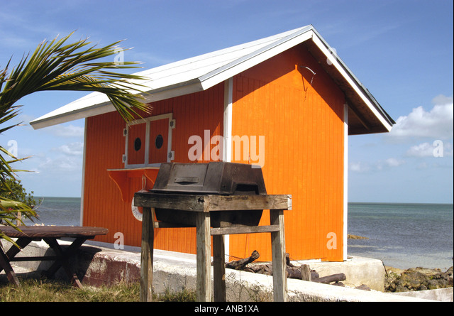 Bahamas Bahamian orange building old charcoal grill islands - Stock Image