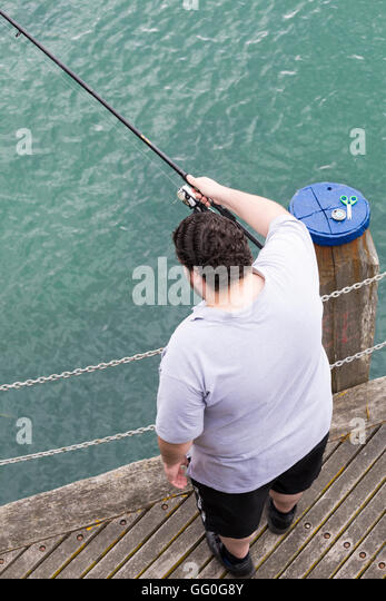Fat man on beach stock photos fat man on beach stock for Fat guy fishing